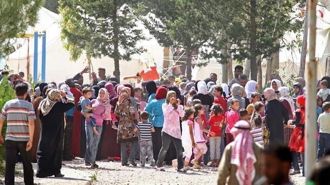 Turquía ya acoge 7.000 refugiados sirios mientras se suceden las condenas