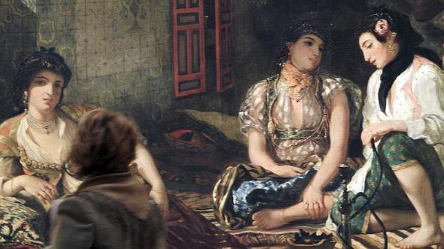 Una joven admira «Las mujeres de Argel en su aposento», de Delacroix. EFE
