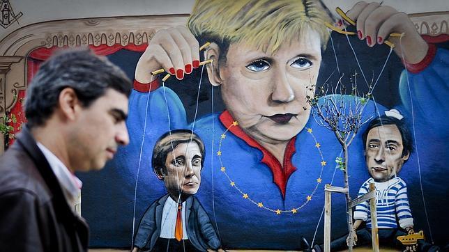"""Los portugueses recuerdan a Merkel que """"no manda"""" en Portugal Merkel-portugal--644x362"""