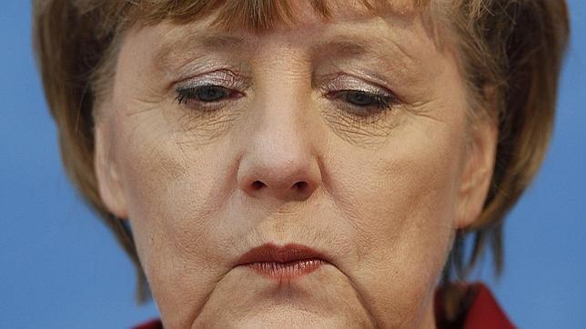 Merkel admite su «amarga» derrota y pide trabajar por la «frágil situación económica»
