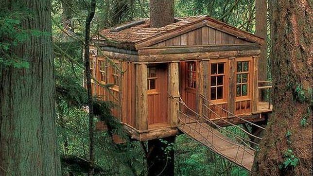 Un pueblo crear caba as en los rboles como alojamiento for Hotel con casas colgadas de los arboles