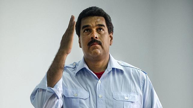 La cara de Nicolás Maduro «se aparece» en un cuadro de Hugo Chávez