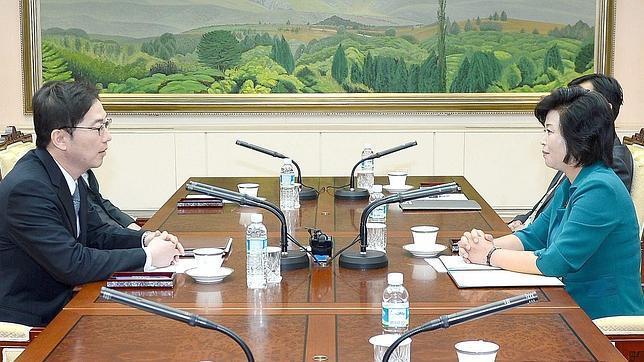 Los delegados en la sala de reuniones