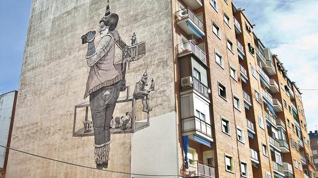 Dibujo realizado en una medianería de Marqués de Viana por el artista urbano San