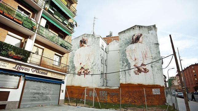 Obra de Borondo sobre la medianería de la calle Marqués de Viana, en Tetuán