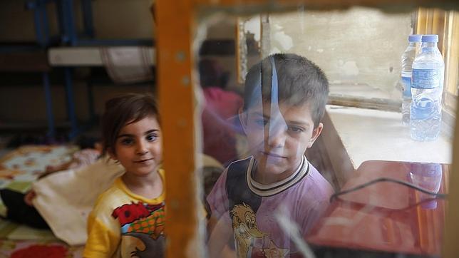 Niños de una familia cristiana refugiada en Erbil, capital del Kurdistán irakí