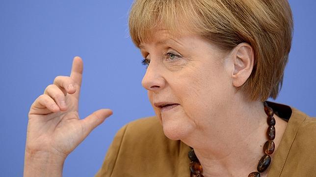 Merkel, escudo entre Rajoy y Mas: «Comparto la posición de España ante Cataluña»
