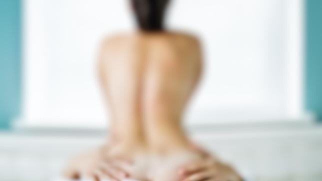 posición de la próstata y dolor de espalda