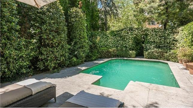 Diez casas con piscina climatizada en madrid for Piscina climatizada madrid