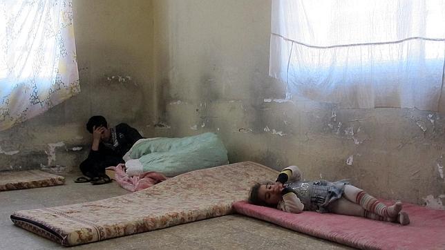 Una familia cristiana caldea refugiada en una habitación en Bagdad