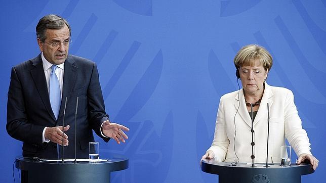 El primer ministro griego, Andonis Samaras, y la canciller alemana, Angela Merkel.