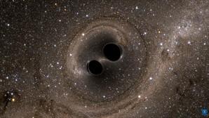 Un par de agujeros negros en colisión