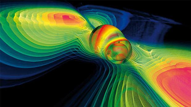 Simulación por ordenador de la fusión de dos agujeros negros y de ondas gravitacionales liberadas