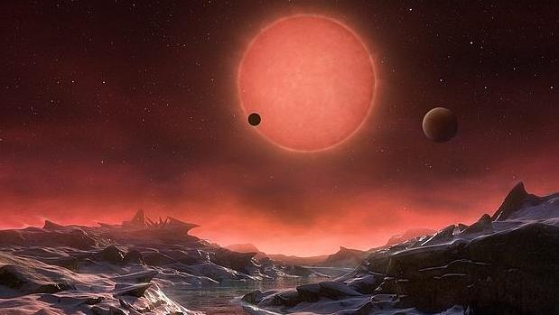 Recreación de la estrella Trappist-1, vista desde uno de los tres planetas que la orbitan