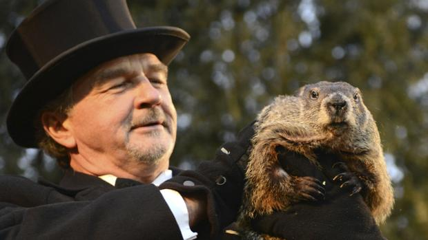 Groundhog co-handler John Griffiths holds up groundhog Punxsutawney Phil after Phil's annual weather prediction on Gobbler's Knob on the 130th Groundhog Day in Punxsutawney, Pennsylvania February 2, 2016. Punxsutawney Phil, a famed U.S. groundhog with an even more famous shadow, emerged from his burrow on Tuesday and predicted an early spring.