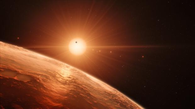 Representación de la estrella Trappist-1, situada a 40 años luz de distancia, y sus siete planetas