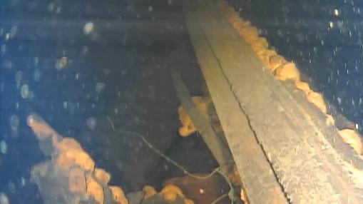 Restos de una pared en el interior del reactor 3 de Fukushima, con restos de lo que parece ser combustible fundido