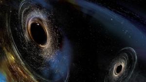 La ilustración muestra dos agujeros negros en proceso de fusión, como los detectados por LIGO