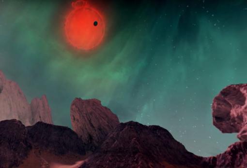 Imagen desde uno de los exoplanetas. El sol es una enana roja y el cielo está surcado por auroras