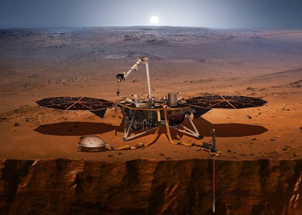 Representación de la sonda «Insight». Tiene un sismógrafo (a la izquierda, posado en el suelo) y perforará la superficie (a la derecha) para medir la temperatura