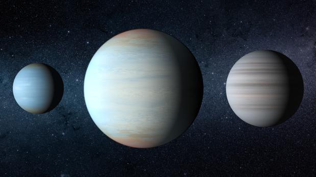 Recreación artística de los tres planetas del sistema Kepler-47. El gran planeta del medio es el recién descubierto