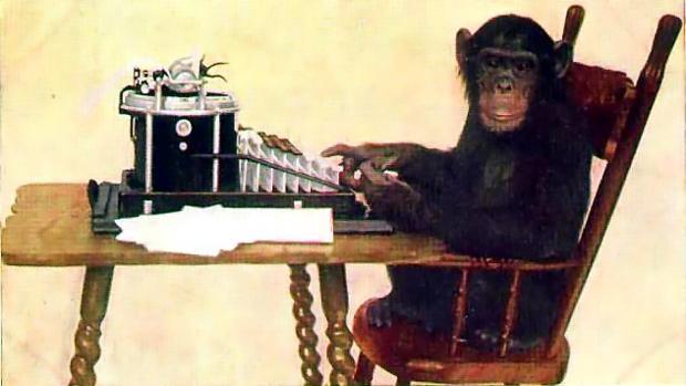 Un mono frente a una máquina de escribir