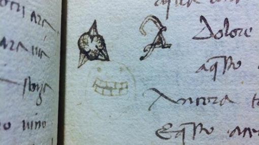 Una cara dibujada sobre un manustrito del siglo XV