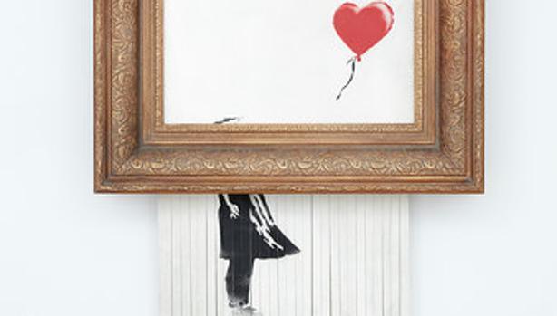 La obra de Banksy triturada en una subasta
