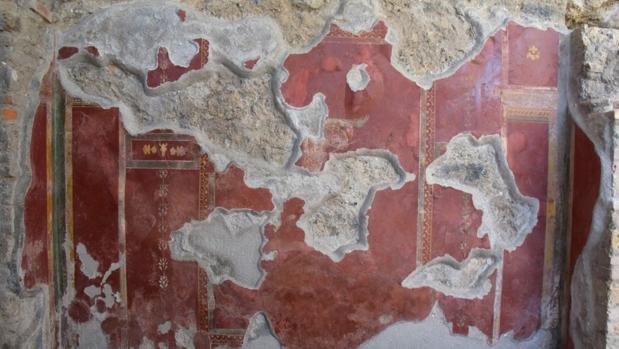 Una imagen de una de las paredes de los Gladiadores de Pompeya tras su restauración