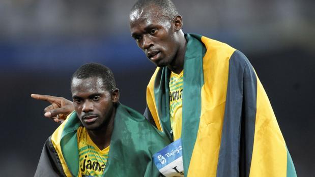 Bolt y Nesta Carter