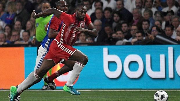 Usain Bolt, durante un partido amistoso