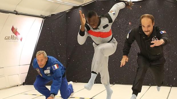 Usain Bolt, durante su carrera contra los astronautas franceses Clervoy y De Gaulle