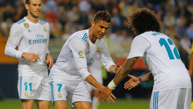 Cristiano y Marcelo celebran un gol