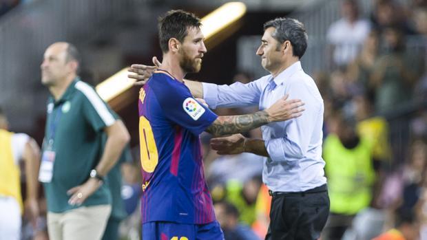 Leo Messi y Valverde durante un partido del Barcelona