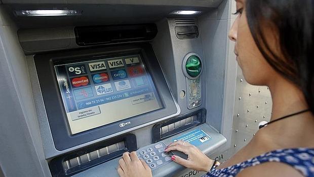 Consumo c mo recuperar el dinero que se traga el cajero for Cajeros banco santander para ingresar dinero