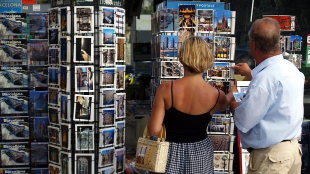 Turistas en el Paseo de Gracia de Barcelona