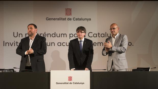 Junqueras, Puigdemont y Romeva, durante la presentación del referéndum en Madrid
