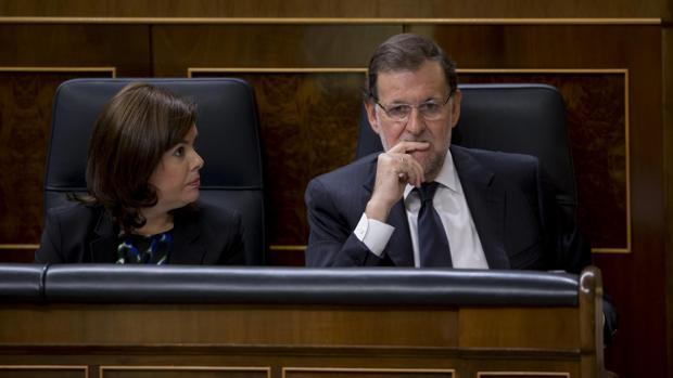 Sáenz de Santamaría y Mariano Rajoy, en una imagen de archivo