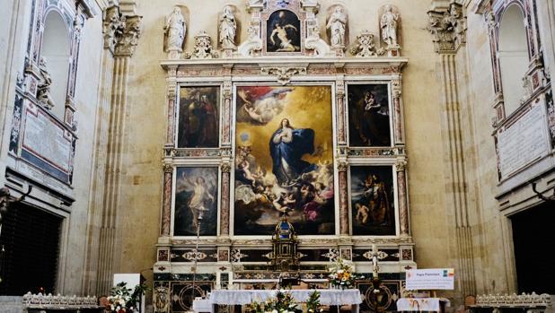 El cuadro de San Agustín, abajo a la derecha del retablo