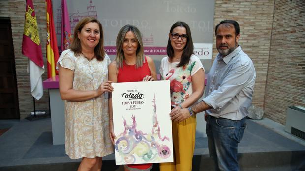 La alcaldesa manteniendo el cartel ganador que representa la Feria y Fiestas 2018
