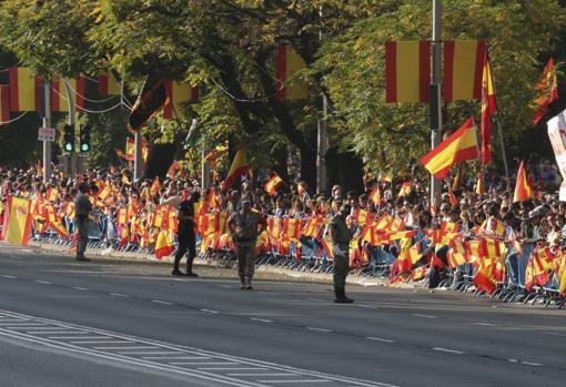 Desfile militar en el día de la Fiesta Nacional, presidido por don Felipe VI y doña Letizia