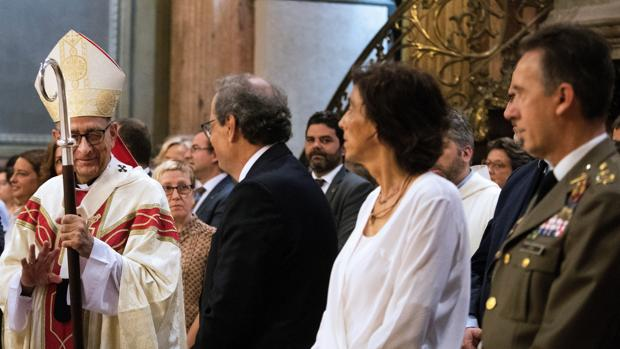 Quim Torra y su esposa, durante la Misa de Fiesta Mayor de la Merced, en Barcelona