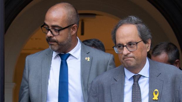 El consejero de Interior, Miquel Buch, y el presidente catalán, Quim Torra