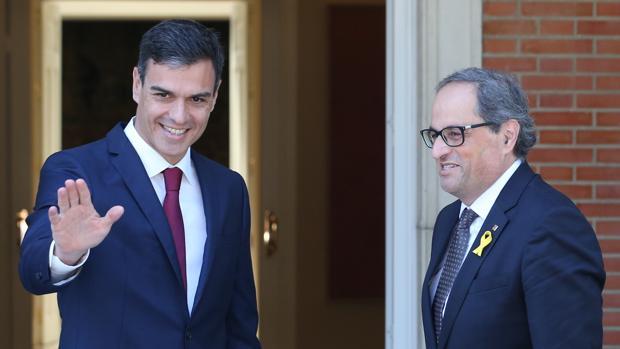 El presidente del Gobierno, Pedro Sánchez, y el presidente catalán, Quim Torra