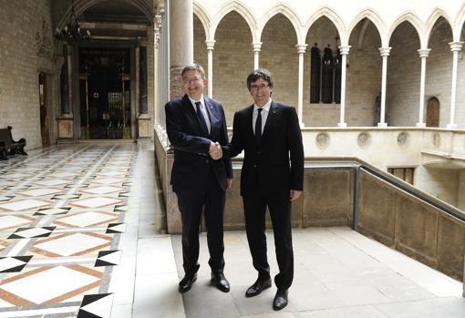 Imagen de la reunión de mayo de hace dos años entre Puigdemont y Puig