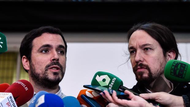 Pablo Iglesias, secretario general de Podemos y Alberto Garzon, coordinador federal de IU, en la reunión del espacio Rumbo 2020, en diciembre