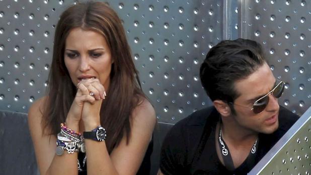 El cantante David Bustamante y Paula Echevarría durante un partido de tenis entre Rafa Nadaly Roger Federer