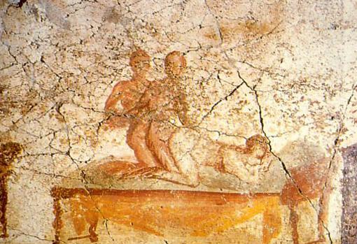 Dos hombres y una mujer en un fresco de Pompeya.