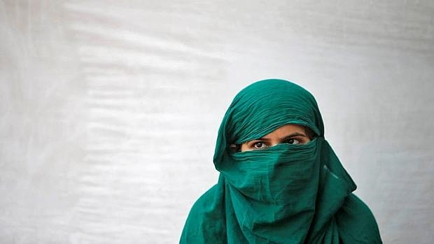 Una mujer india, víctima de una violación, durante una protesta en Nueva Delhi