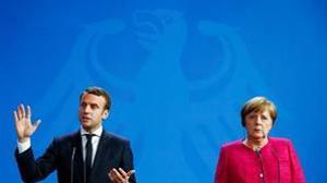 Macron y Merkel durante la rueda de prensa en Berlín
